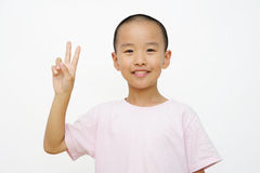 Child and  two fingers. A Chinese child raised his two fingers Royalty Free Stock Photos