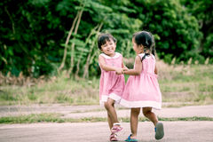 Child two girls having fun to play together Stock Photography