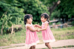 Child two girls having fun to play together Stock Photo