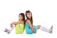 A child, two girls sitting there. Royalty Free Stock Photos