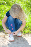 Child tying shoe. Royalty Free Stock Images