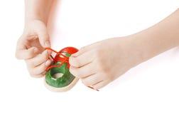 Child tying shoelaces Stock Photo