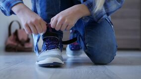 Child tying shoes laces, kid preparing leave house, girl going school, shoelaces