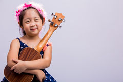 Child with Ukulele Royalty Free Stock Photos