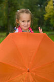 Child and umbrella. Little girl with orange umbrella in park. Autumn Stock Photos