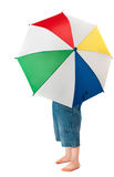 Child with umbrella. Happy child posing with a multi color umbrealla Royalty Free Stock Photo