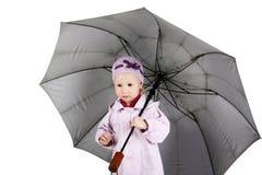 Child with umbrella Stock Image