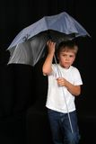 Child with an umbrella Royalty Free Stock Images