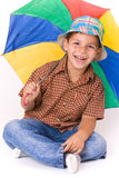Child with umbrella. And smile Stock Images