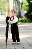 Child with umbrella in hands Stock Photos