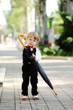 Child with umbrella in hands Royalty Free Stock Photography