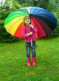 Child with umbrella outdoors Royalty Free Stock Photo