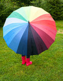 Child with umbrella outdoors Stock Image