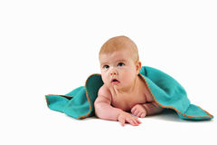 Child under blanket Stock Images