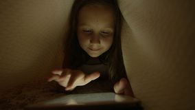 Child Under the Blanket Playing with Tablet stock footage