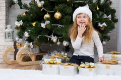 Child under the Christmas tree Stock Photo