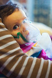 Child under medical treatment. Nebuliser respiratory therapy stock images
