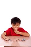 Child under meditation. Of sore throat playing toy car royalty free stock photos