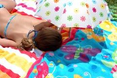 Child under umbrella. Child asleep under umbrella stock image
