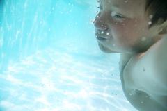 Child underwater in sea or pool Stock Photos