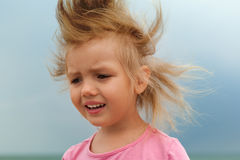 Child unhappy face gray stormy sky Royalty Free Stock Image