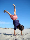 Child upside down stock photography