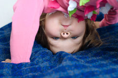 Child with upside down head looking Royalty Free Stock Image