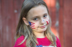 Child with USA Painted Face. Little girl with USA Flag painted on her face Stock Photography