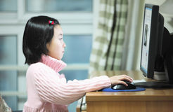 Child use computer. Chinese little child use the computer Royalty Free Stock Photography
