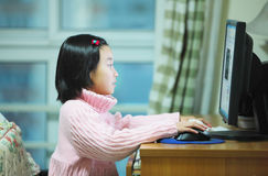 Child use computer Royalty Free Stock Image
