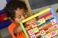 Child Using Abacus Royalty Free Stock Photos