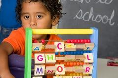 Child Using Abacus Stock Photo