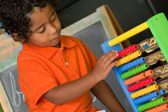 Child Using Abacus Stock Photography