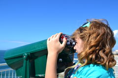 Child using binoculars Stock Images