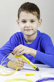 Child using 3D printing pen. Creative, technology, leisure, education concept. Boy using 3D printing pen. Creative, leisure, technology education concept Royalty Free Stock Images