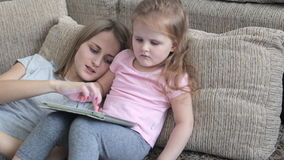 Child using a digital tablet stock video