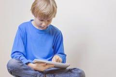 Child using digital tablet computer Stock Image