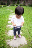Child using a digital tablet or smart phone Stock Image
