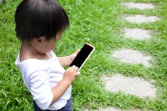 Child using a digital tablet or smart phone Stock Photo