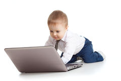 Child using a laptop. Baby boy using a laptop Royalty Free Stock Images