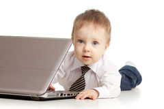Child using a laptop. Over white backgound Stock Image