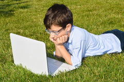Child using laptop Stock Images