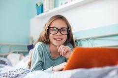 Child using laptop Stock Image