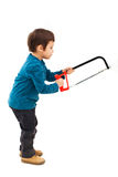 Child using saw Stock Photo