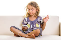 Child using smartphone at home Royalty Free Stock Photo