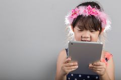 Child Using Tablet Background. Girl Playing Tablet Background Royalty Free Stock Image