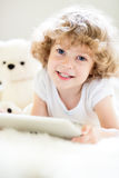Child using tablet computer. Portrait of smiling child using tablet computer Royalty Free Stock Images