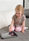 Child using tablet computer Stock Photo