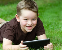 Child using tablet computer Stock Image