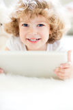 Child using tablet pc Royalty Free Stock Photography